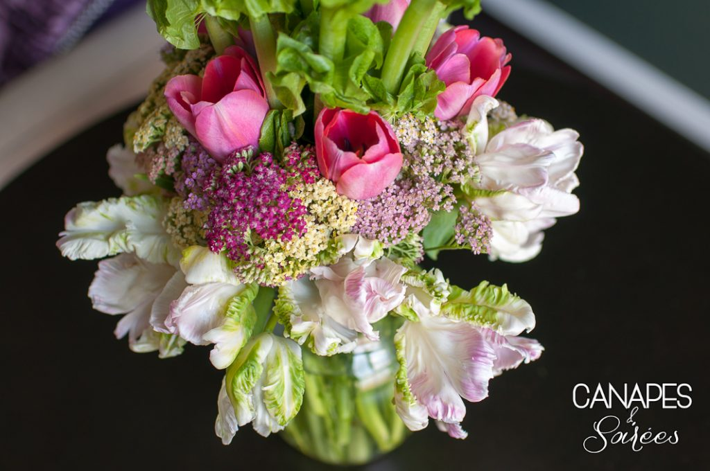 Spring tulips and Texas wildflowers in a tall spring floral arrangement