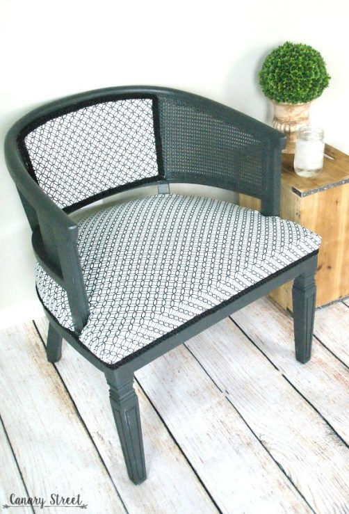 Black and white reupholstered chair.  Painted with Annie Sloan Graphite chalk paint.  https://canarystreetcrafts.com/