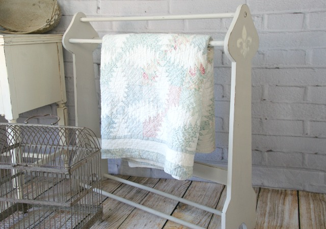 Thrift store blanket rack makeover.  Painted with chalk paint and a fleur de lis.  http://canarystreetcrafts.com/.