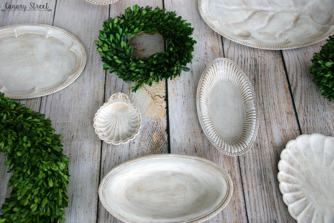 Home decor doesn't have to be expensive! You can find cheap plates and platters at any thrift store and easily transform them into unique decor. https://canarystreetcrafts.com/