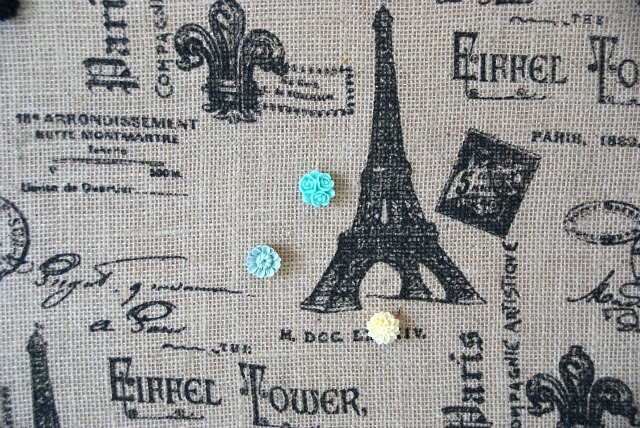 Tutorial explaining how to easily update a plain cork board with burlap or fabric and make pretty DIY thumb tacks. canarystreetcrafts.com