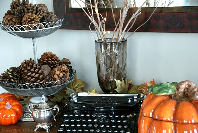 Easy and inexpensive fall decorating ideas.  Pinecones and branches from the yard.  Dollar store pumpkins and random stuff from around the house.