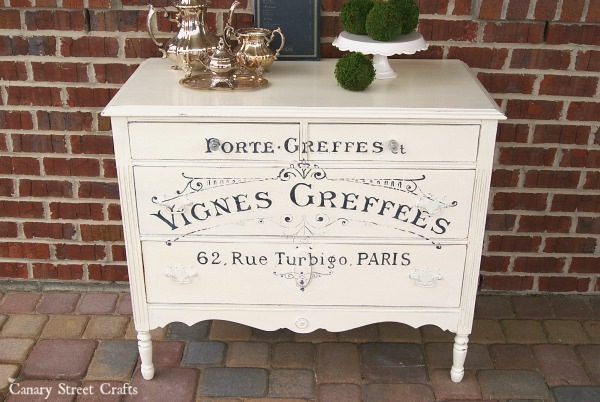 Gorgeous dresser painted with Annie Sloan chalk paint. The French Winemaker graphic was hand painted using an easy technique. {Canary Street Crafts}