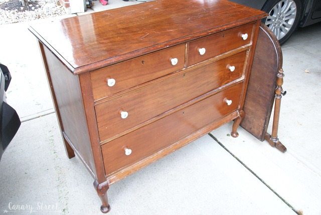 BEFORE- pretty dresser makeover using Annie Sloan's Paris Grey and Old White chalk paint.  https://canarystreetcrafts.com/