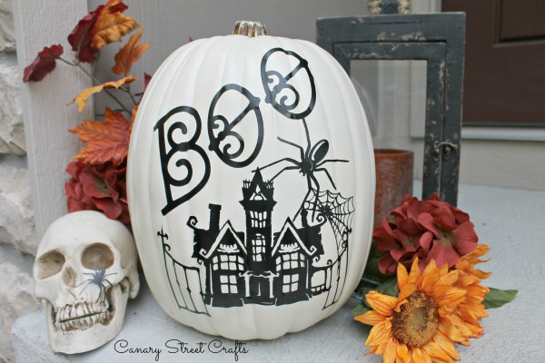 Pumpkin decorated with vinyl decals using a Cricut machine {Canary Street Crafts}
