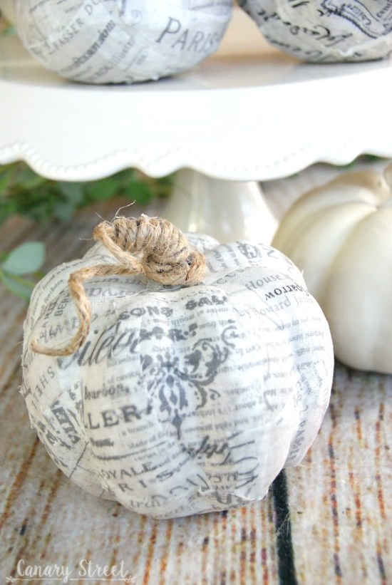 Easy way to update faux pumpkins! Use Mod Podge to cover faux pumpkins with any fabric or paper. Wrap twine around the stem. http://canarystreetcrafts.com/