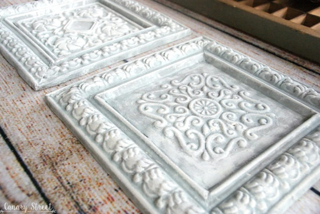 Painted metal tiles. Using thrift store items to create your own unique and inexpensive home decor. https://canarystreetcrafts.com/