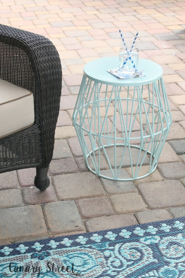 Progress on the patio- canarystreetcrafts.com. Favorite decor items for a fun and functional outdoor space.