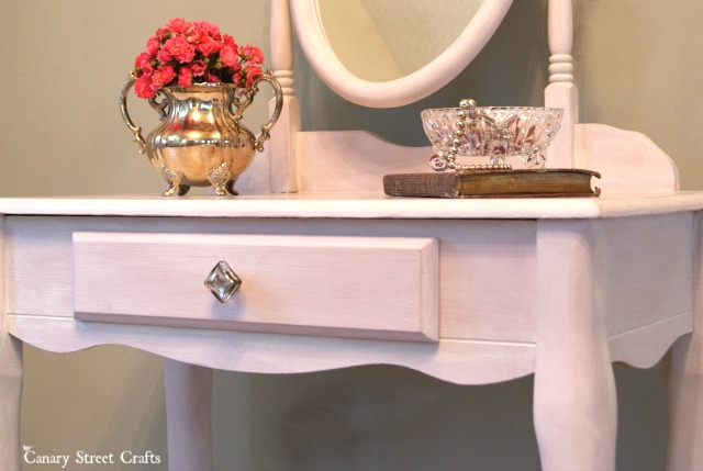 Pink vanity makeover using Annie Sloan's Henrietta chalk paint and a whitewashed finish.