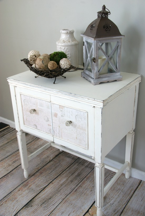 An inexpensive, old sewing cabinet made over into a pretty nightstand.  https://canarystreetcrafts.com/