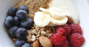 Top with ground flax seeds, assorted berries, and sliced bananas.