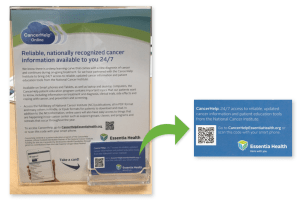 Photo of flyer in holder with business card