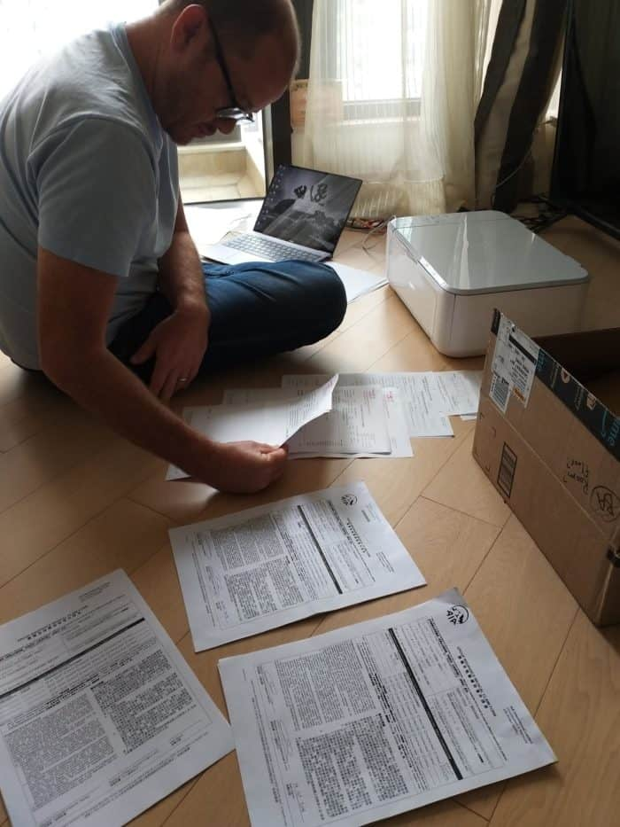 Brad sorting through insurance paperwork