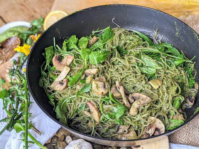 Healing dandelion green pesto tossed with kelp noodles and mushrooms is a perfect plant-based keto meal.