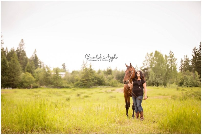 Girl and her Horse Standing In Field