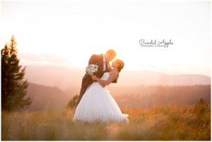 Bride and Groom dipping at Sunset