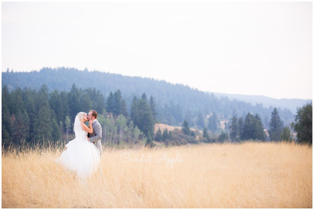 Couple Standing in a Beautiful Pasture in Vernon, BC