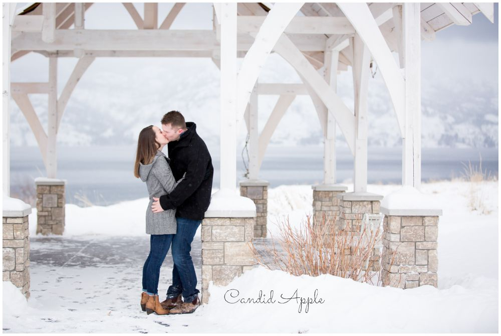 Couple Kissing Under Wintery Gazebo with Beautiful View