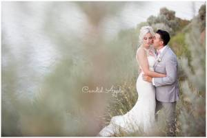 A couple on their wedding day in the sage brush overlooking the Okanagan Lake