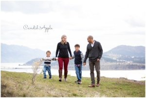 A family walking holding hands on the mountain