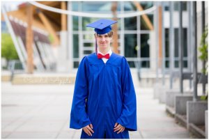 A grad dressed in his cap and gown