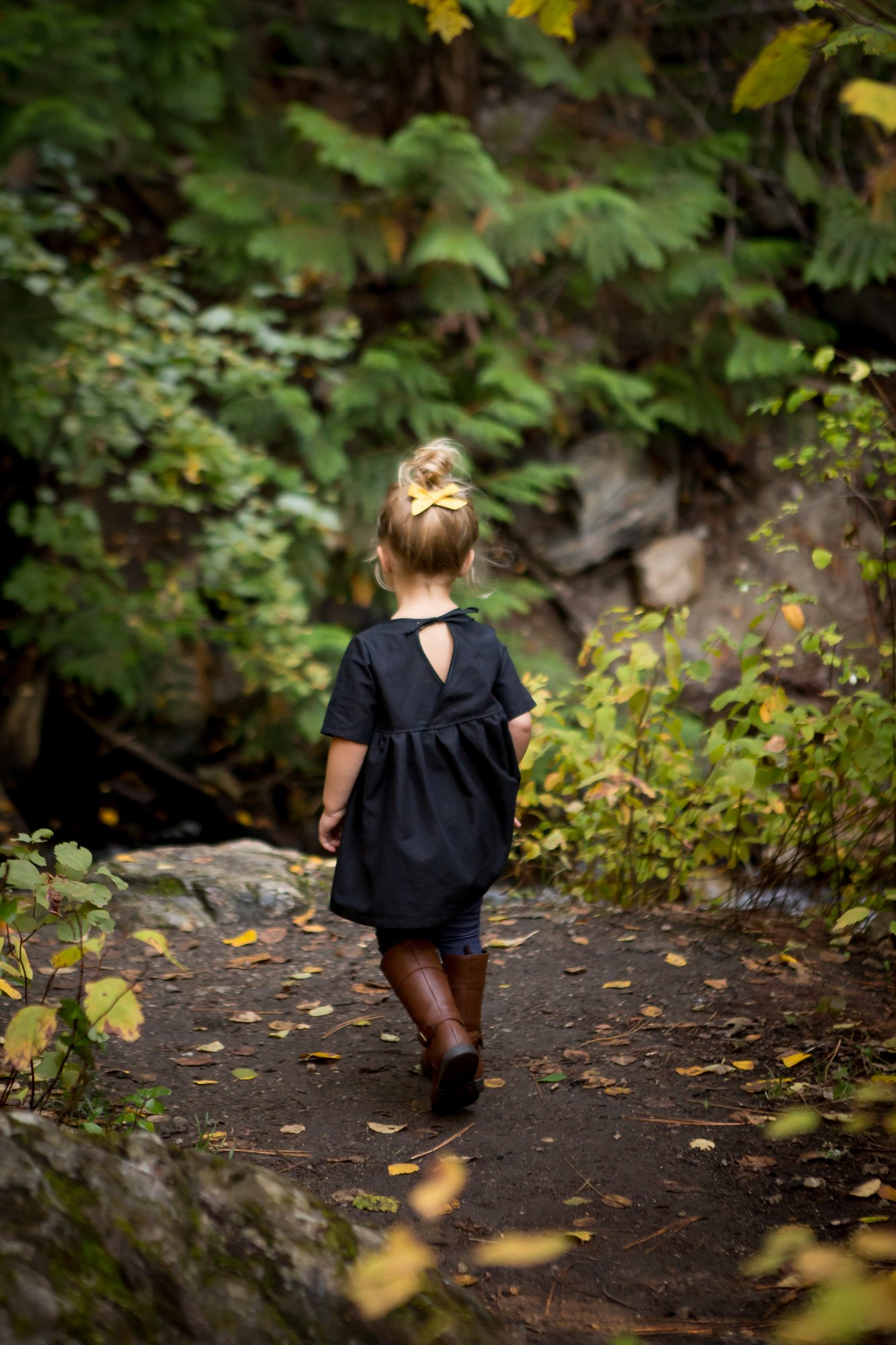 A little girl walking in the forest