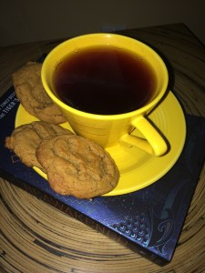 cup of tea and cookies with book.