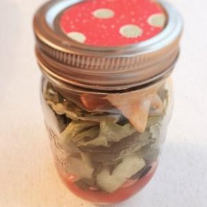 Image of greek salad in a mason jar