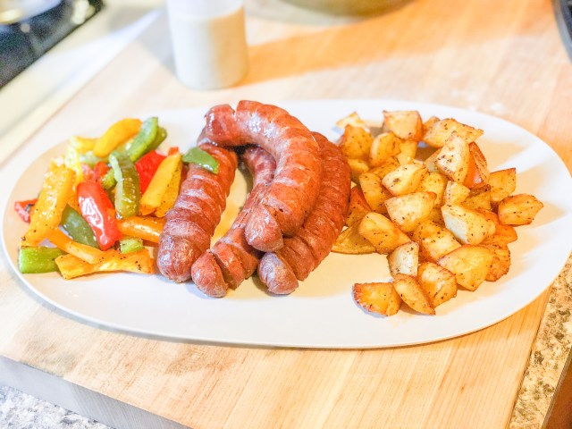 Easy, kosher sheetpan dinner, sausage and peppers with roasted potatoes and creamy honey mustard.