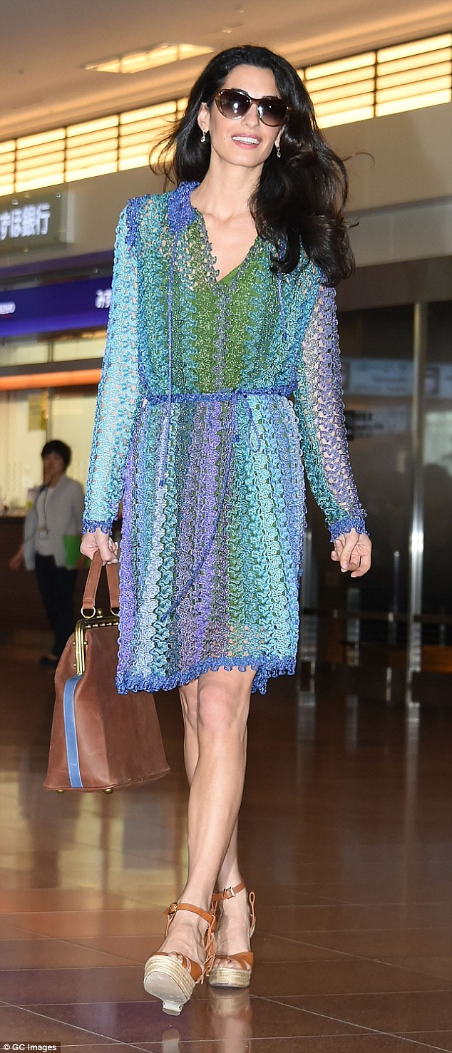 Lawyer and activist Amal Clooney looks gorgeous in Tokyo, Japan in a beautiful Missoni dress and fabulous Valentino C-Rockee Leather Fringe Wedge Sandals. Photo credit: GC Images. Image courtesy of DailyMail.com