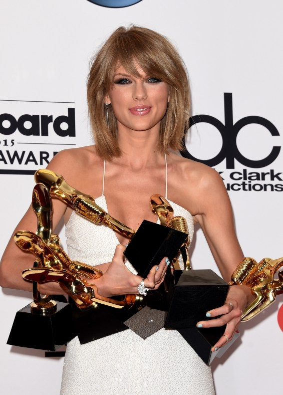 LAS VEGAS, NV - MAY 17:  Musician Taylor Swift poses in the press room with her eight Billboard Music Awards; Swift won Top Artist, Top Female Artist, Top Billboard 200 Artist, Top Billboard 200 Album for '1989,' Top Hot 100 Artist, Top Digital Songs Artist, Top Streaming Song (Video) for 'Shake It Off,' and Billboard Chart Achievement Award during the 2015 Billboard Music Awards at MGM Grand Garden Arena on May 17, 2015 in Las Vegas, Nevada.  (Photo by Jason Merritt/Getty Images)