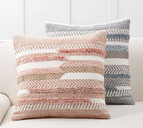 trendy textured throw pillows in a