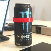 red CanDo label around a dewy Monster energy drink can