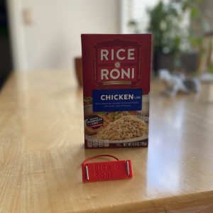 a Rice a Roni braille label back view with the engraved text showing next to a box