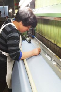 Part of the tie manufacturing process: creating woven labels