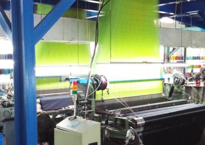 Part of the tie manufacturing process: jacquard weaving loom