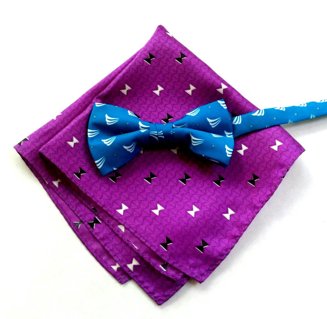 Camby Hotel purple silk pocket square with a blue Seacoast Commerce Bank pre-tied bow tie