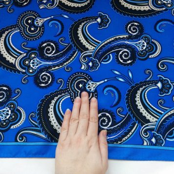 Hand for scale of the paisley print