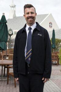 Salvation Army volunteer, wearing a tie