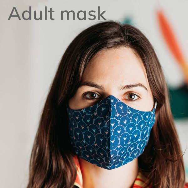 model wearing an adult size face mask with navy blue martini pattern