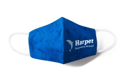front view of blue custom face mask with dolphin pattern and Harper Elementary School logo