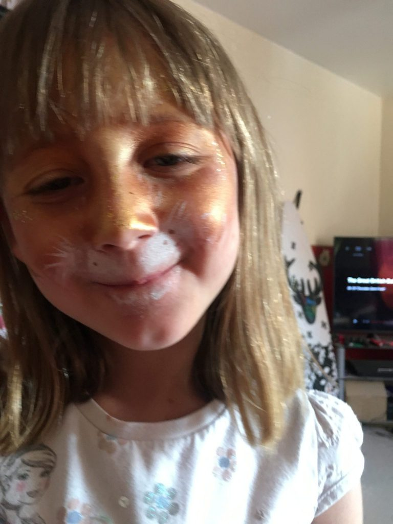 daughter with face painted like golden rabbit