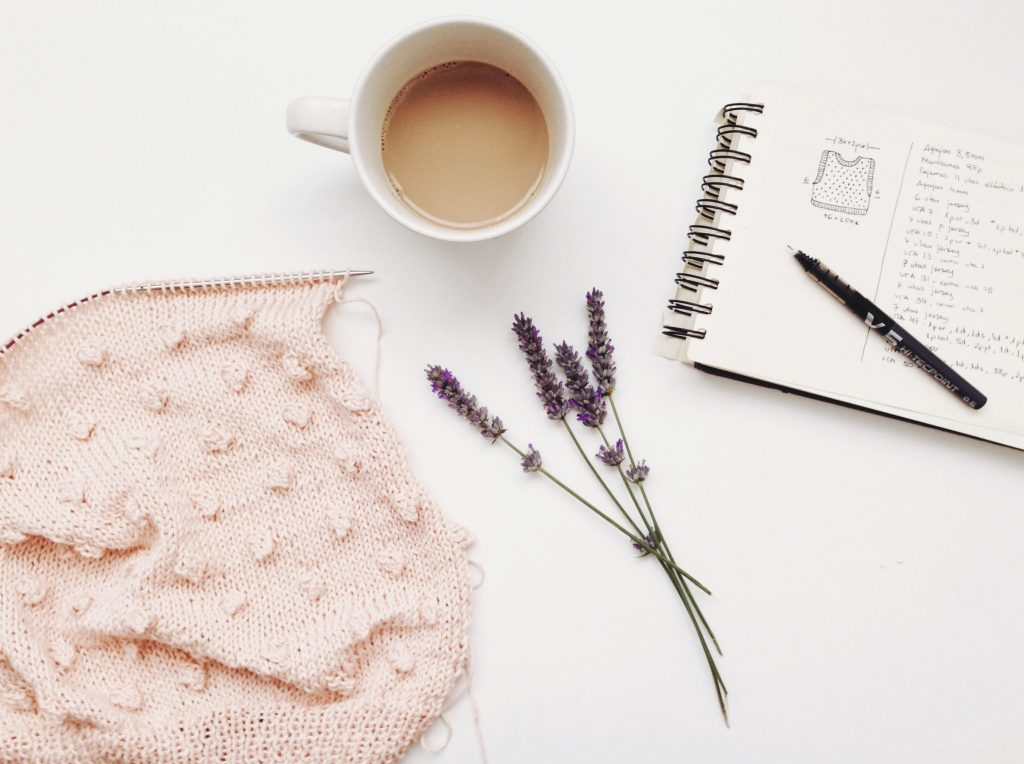 planning with coffee, blanket and flowers. Hiring a Doula