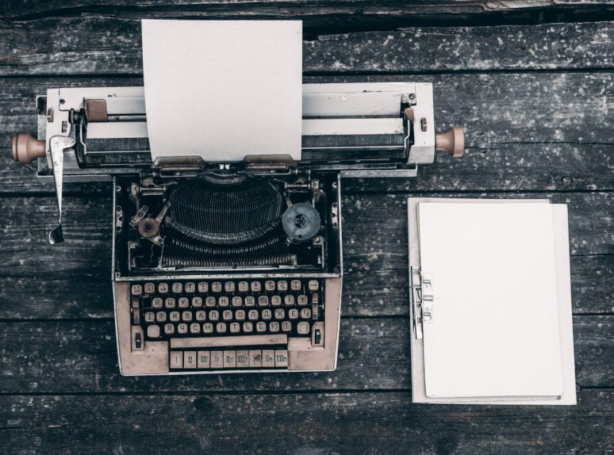 help a child write essays, typewriter and notebook