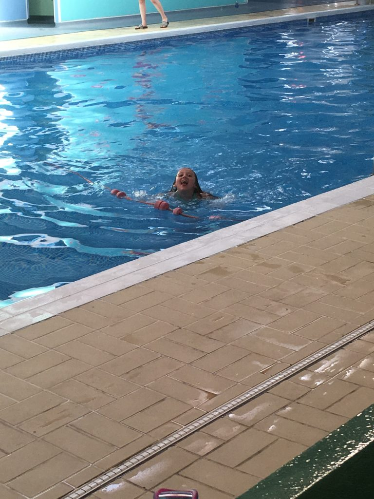 Evie swimming in the indoor pool at Thorness Bay holiday park