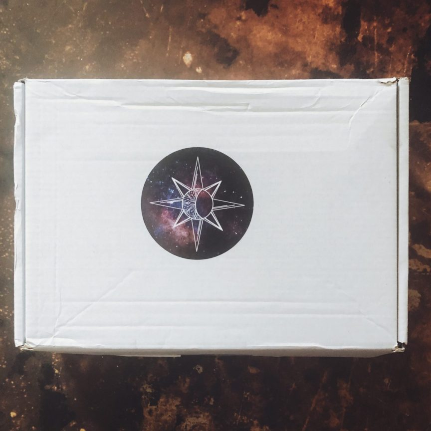 a moonlight crate box on a copper background. this is a moonlight crate book box unboxing.