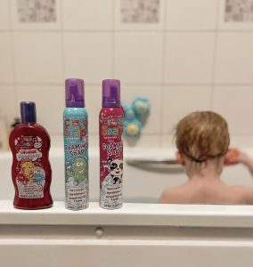kids stuff crazy bathtime range products on show with a toddler facing the wall in the bathroom