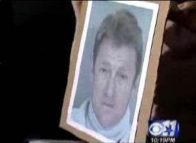A screenshot of Stan Tucker's mugshot from a Channel 11 report.
