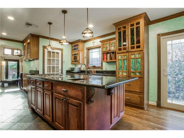 Top-of-the-line kitchen features a large center island, ample co