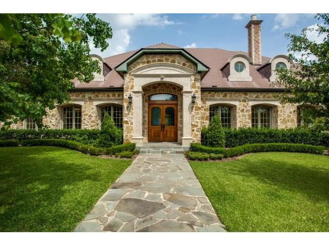 Stunning! Main house is 6600+ sq ft. All on one floor except for